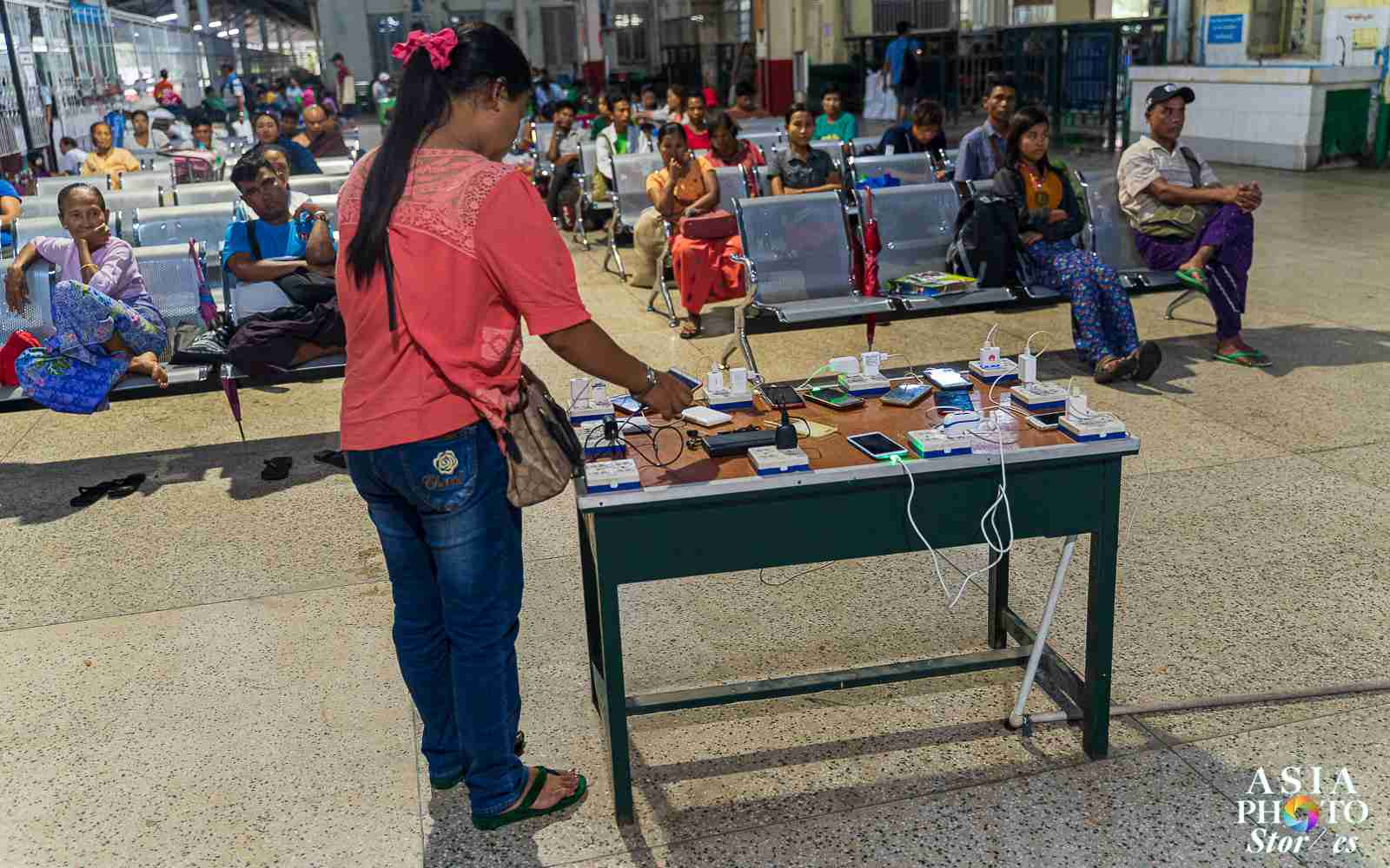 A table full of power bars is a free charging station at the Yangon Central Train Station.