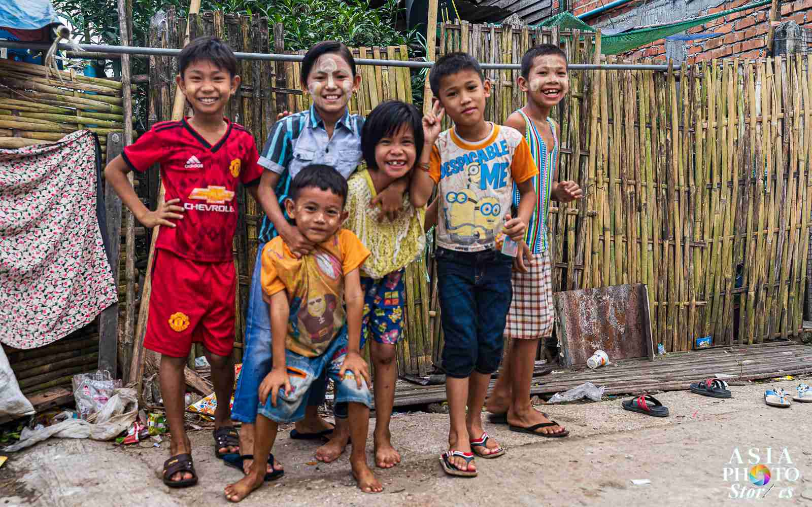 Children pose for the camera at a slum village off the Yangon train line.