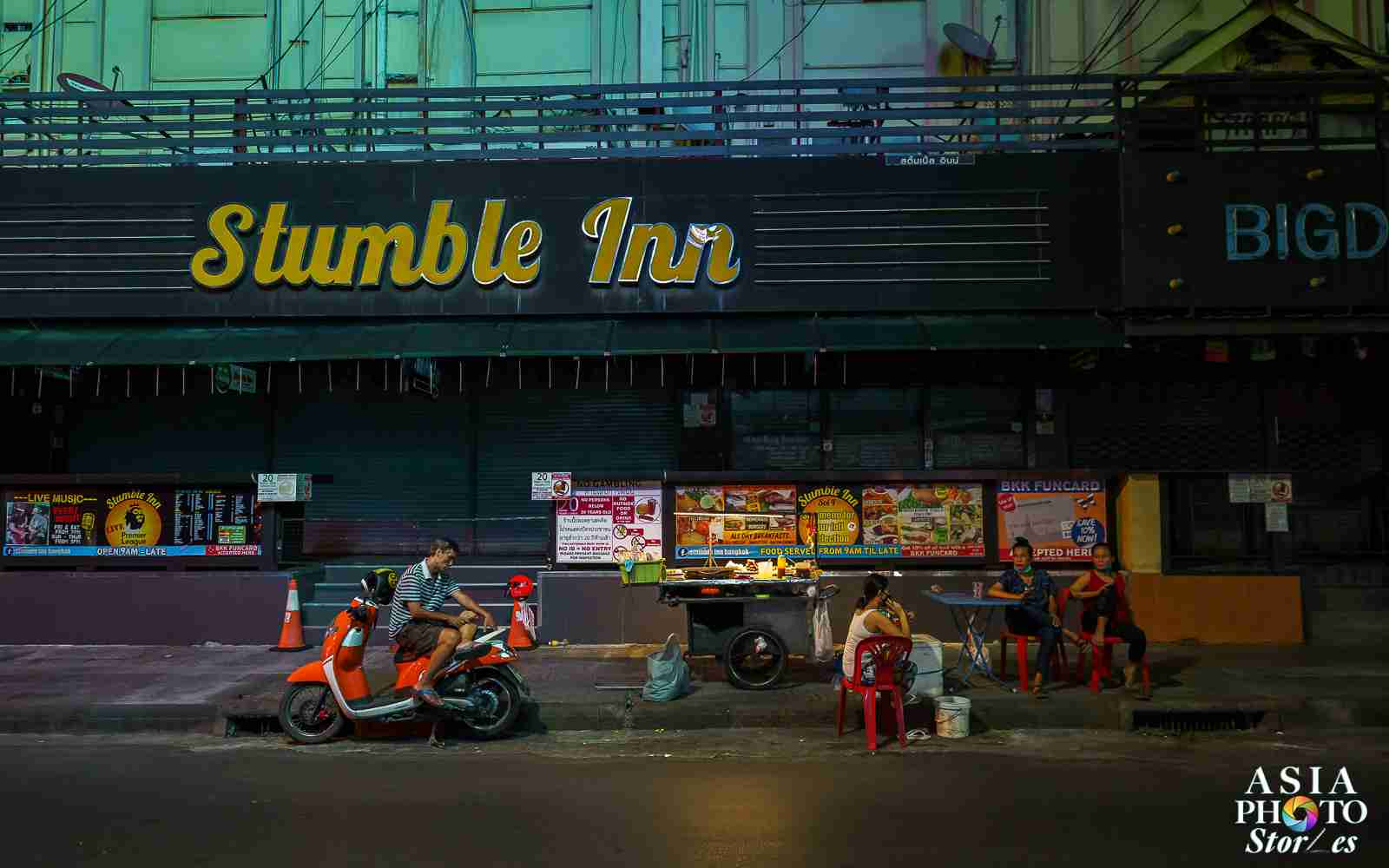 A single street vendor remains outside the closed Nana Plaza adult entertainment complex on Sukhumvit Soi 4 in Bangkok.