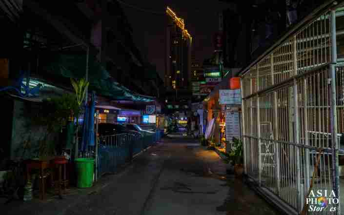 "Sukhumvit Soi 7/1, a street normally teeming with woman and transvestites offering ""happy ending"" massages, sex and oral pleasures is dark and deserted during the coronavirus pandemic."