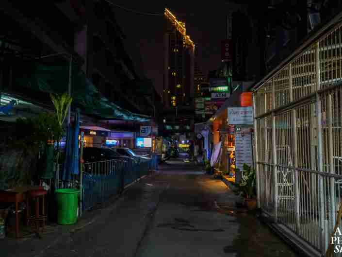 """Sukhumvit Soi 7/1, a street normally teeming with woman and transvestites offering """"happy ending"""" massages, sex and oral pleasures is dark and deserted during the coronavirus pandemic."""