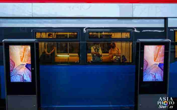 Masked passengers sit on a sparsely populated Skytrain BTS car during evening rush hour April 2.