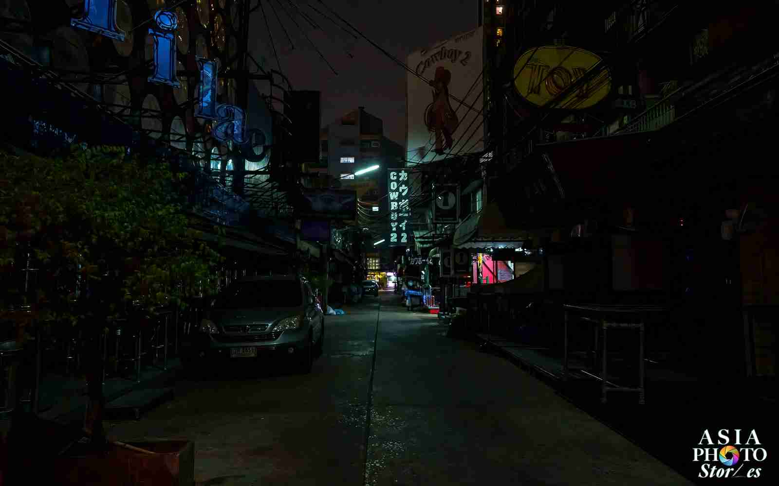 Soi Cowboy is nearly pitch dark. Closed March 18, it's uncertain when Bangkok's world-famous red light district will reopen.